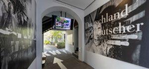 Installation view at the courtyard entryway at KW on the occasion of the re-installation of Katharina Sieverding, Deutschland wird deutscher (1993), 2021; Courtesy the artist and VG Bild-Kunst, Bonn; Photo: Frank Sperling